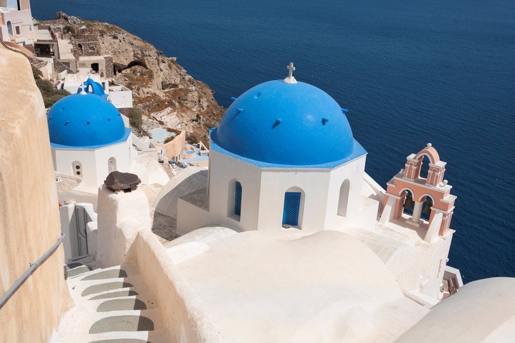 Stock Photo: 4290-9542 Anastasi Church in front and Agios Spiridonas Church behind, Oia, Santorini, Greece