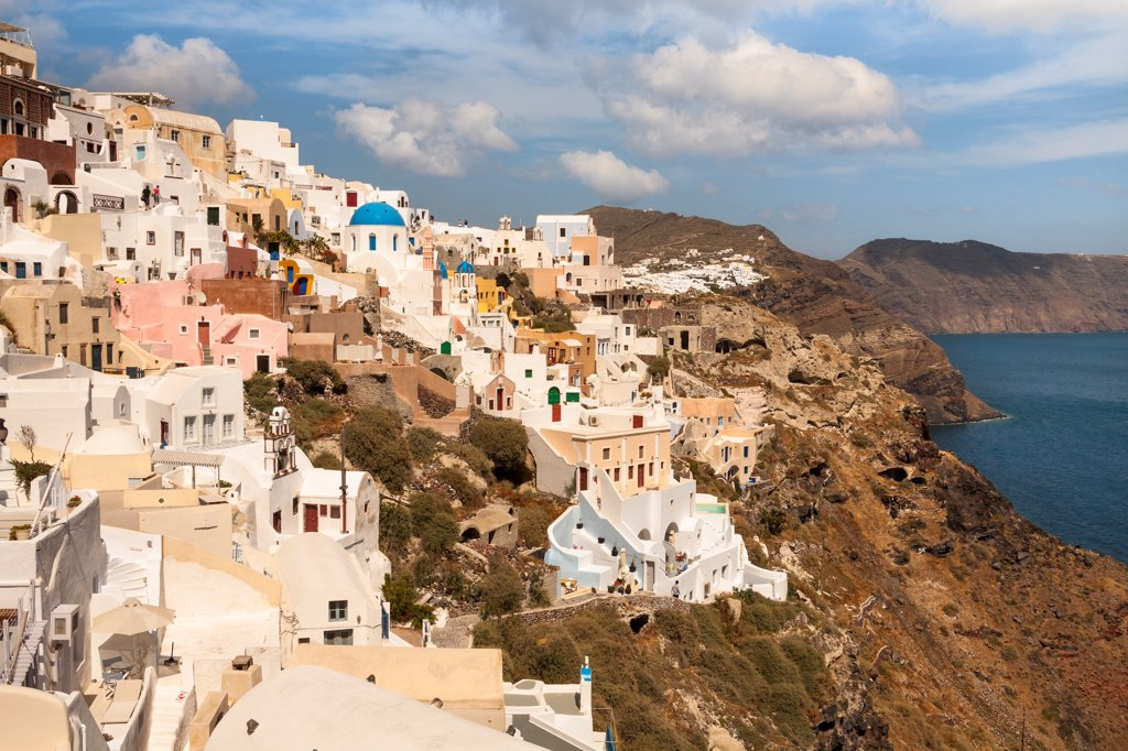 Stock Photo: 4290-9549 Overlooking the clifftop town of Oia, on the Greek island of Santorini, Greece