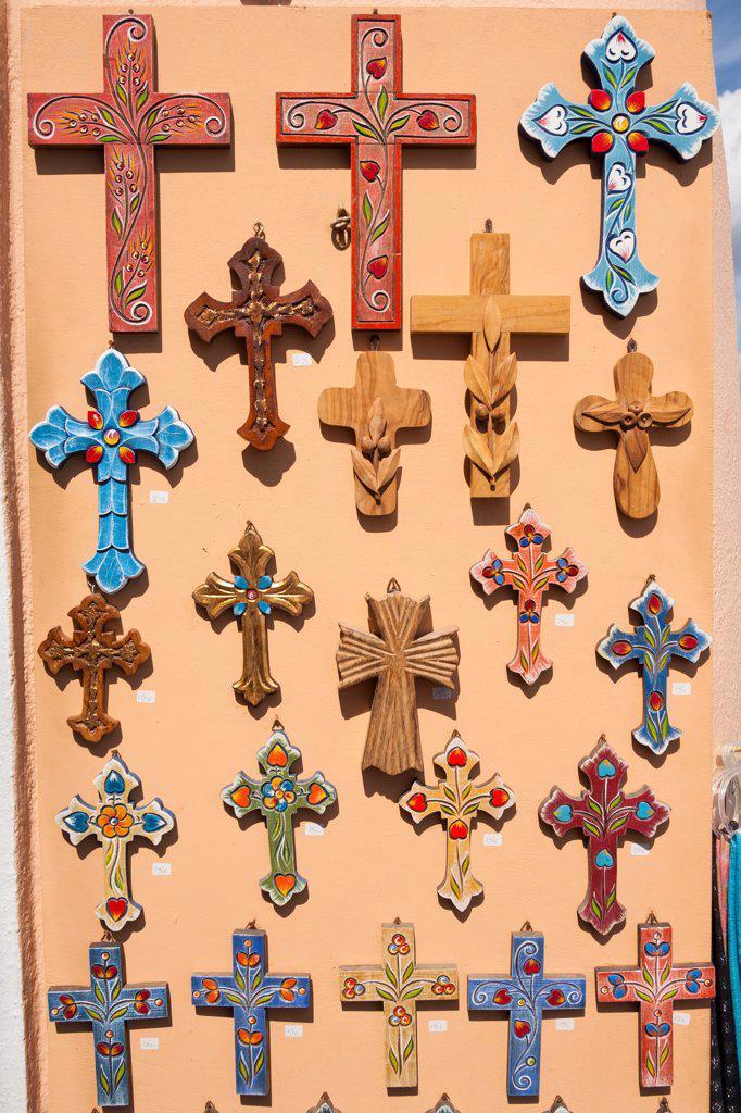Stock Photo: 4290-9550 Decorative colourful religious crucifixes for sale outside a gift shop, Oia, Santorini, Greece