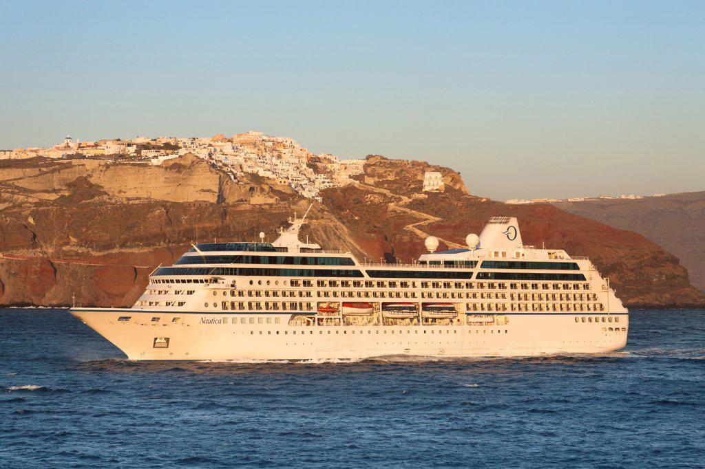 Clifftop village of Oia, and Nautica cruise ship, Santorini, Greece : Stock Photo