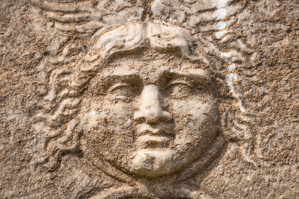 Stock Photo: 4290-9616 Carved stone face detail on a sarcophagus exhibit, Ephesus, Turkey