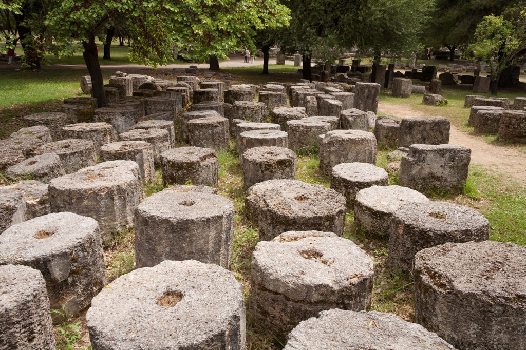Sections of several historic columns, Olympia, Greece : Stock Photo