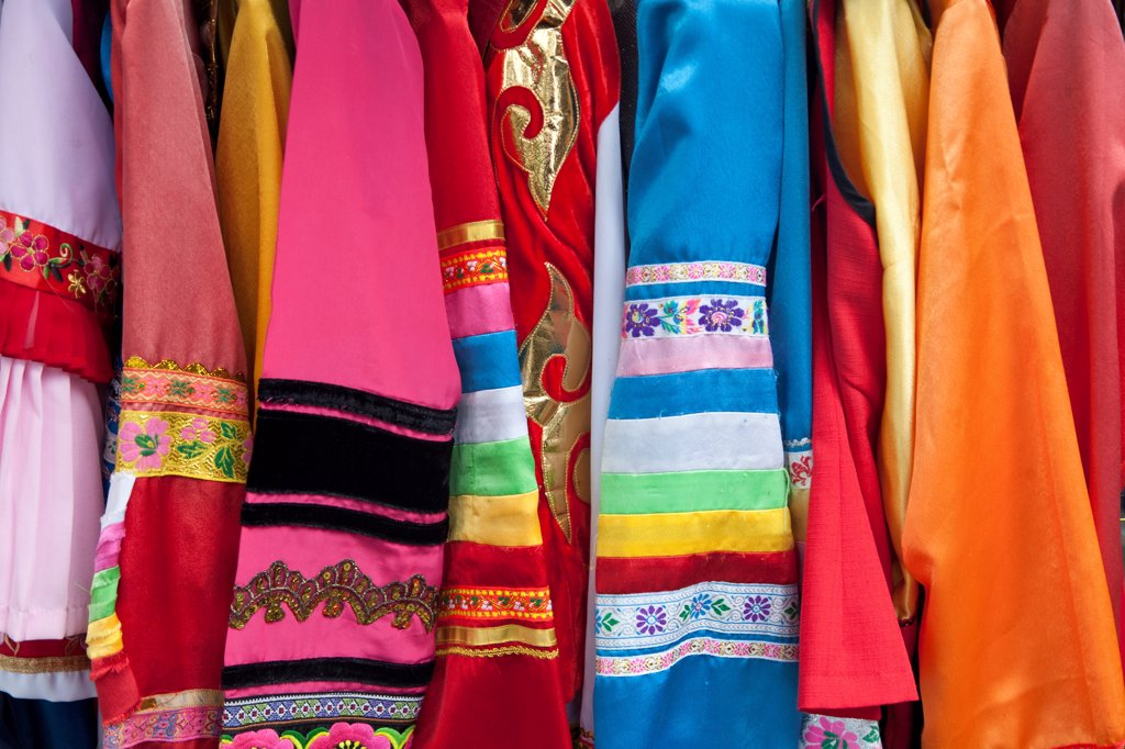 Colourful Chinese silk clothing for sale, Yunnan Province, China : Stock Photo