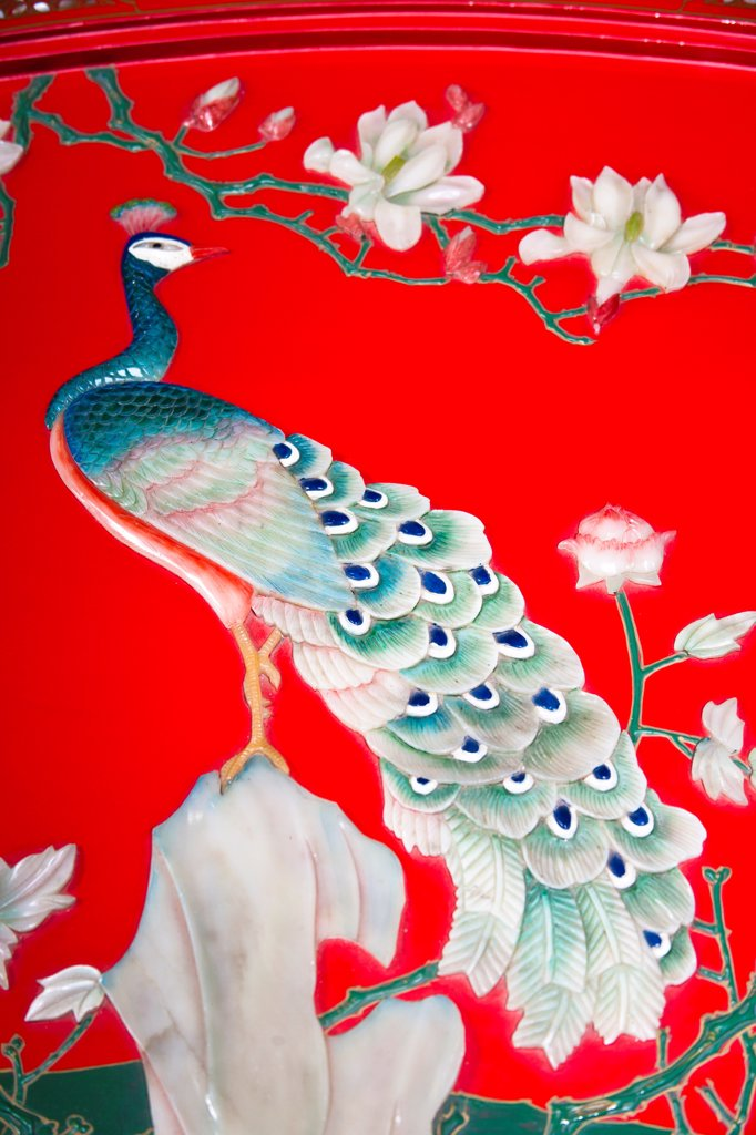 Painted jade peacock on a colourful decorative piece of Chinese furniture, Xi'an, China : Stock Photo