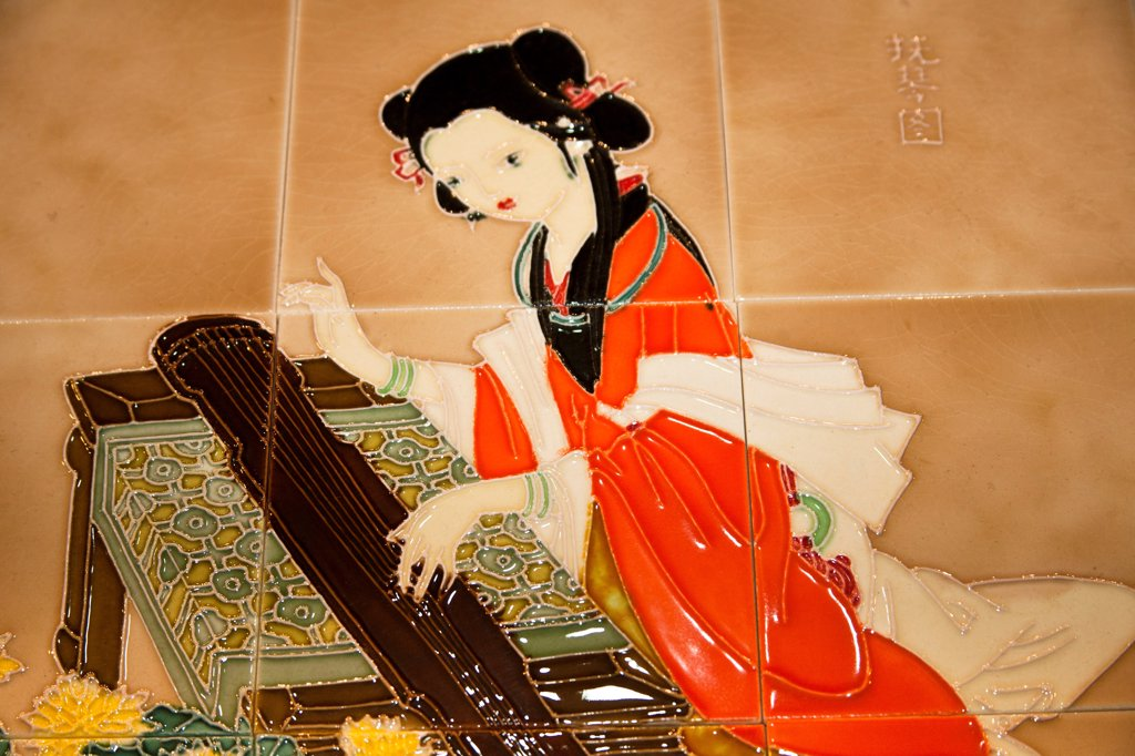 Stock Photo: 4290-9769 Chinese woman playing a stringed musical instrument depicted on ceramic tiles, China