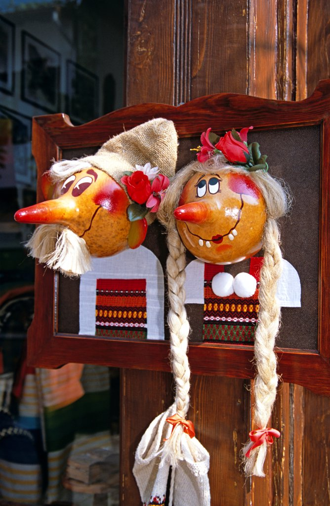 Stock Photo: 4290-9887 Colourful faces with pointed noses mounted on frame outside gift shop, Veliko Tarnovo, Bulgaria