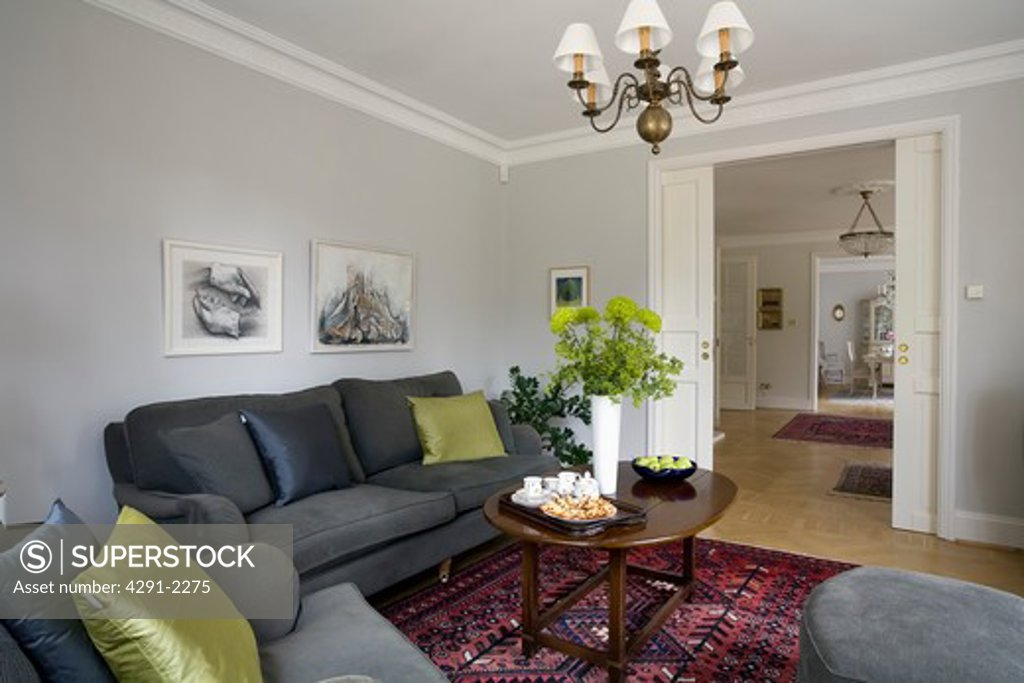 Picture of: Lime Green Cushions On Charcoal Grey Sofas In Pale Grey Living Room With Open Sliding Double Doors Stock Photo 4291 2275 Superstock
