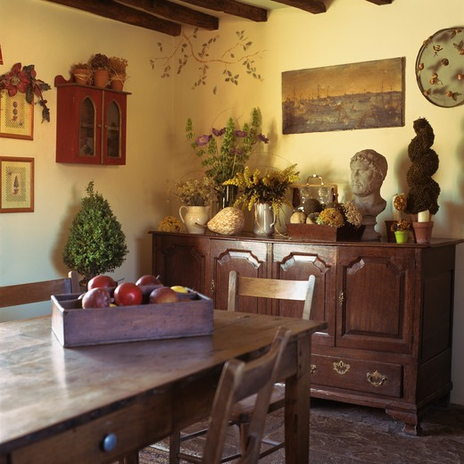 Antique sideboard and table in country dining room : Stock Photo