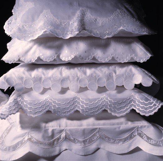Stock Photo: 4291-11878 White pillows in decorative pillow cases in stack