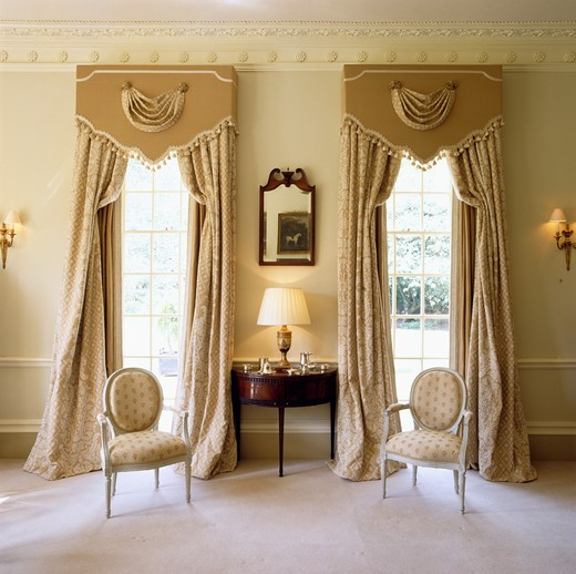 Stock Photo: 4291-12059 Ornate pelmets above cream curtains in traditional drawing room