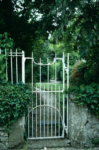 Stock Photo: 4291-1219 White iron garden gate with view of path through country garden
