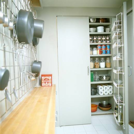 Stock Photo: 4291-12443 Modern galley kitchen with larder cupboard door open to storage shelves
