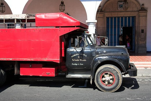Stock Photo: 4291-13040 Lorry parked outside the Ayuntamiento, Town Hall, Parque Cespedes, Santiago de Cuba, Cuba
