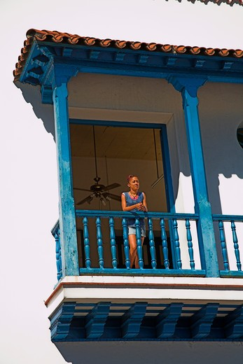 Stock Photo: 4291-13055 Woman on balcony of the Ayuntamiento, Town Hall, Parque Cespedes, Santiago de Cuba, Cuba