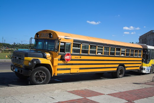 Stock Photo: 4291-13105 Yellow Ford school bus parked at roadside, Havana, La Habana Vieja, Cuba