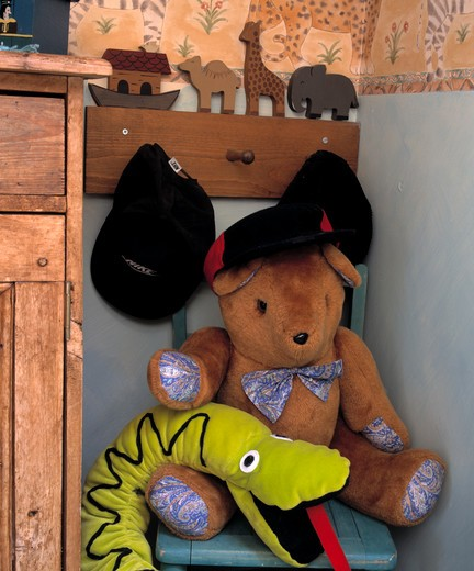 Stock Photo: 4291-14876 Close-up of Noah's Ark pegboard with boys' caps and teddybear with felt snake