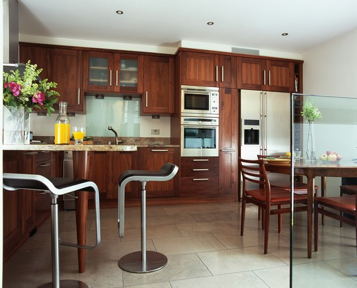 Stainless steel stools in modern kitchen : Stock Photo