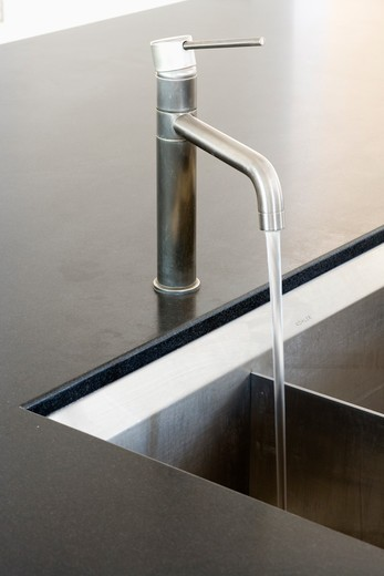 Stock Photo: 4291-16354 Close-up of stainless-steel tap pouring water into underset sink