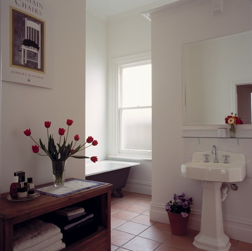 Stock Photo: 4291-17901 White tiled openplan traditional bathroom with with rolltop bath and terracotta floor tiles