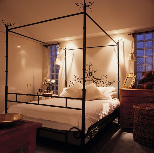Modern Black Metal Four Poster Bed With White Linen In