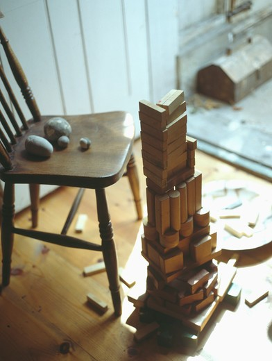 Stock Photo: 4291-19337 Close-up of wooden chair and pile of child's old wooden building blocks
