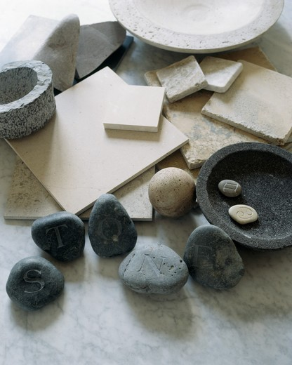 Close-up of pebbles and stone bowls and tiles : Stock Photo