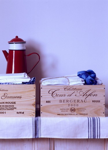 Stock Photo: 4291-21273 Close-up of red enamel coffeepot on old wine boxes