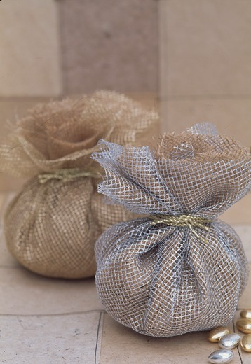 Close-up of silver and gold net gift bags : Stock Photo