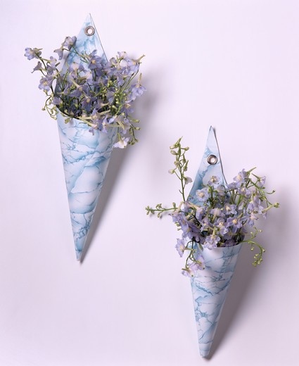 Stock Photo: 4291-23085 Close-up of blue summer flowers in hand-made ceramic cone-shaped wall vases