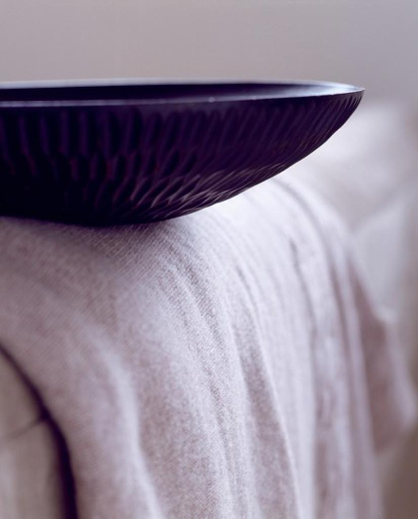 Closeup of black wooden bowl : Stock Photo