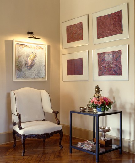 Stock Photo: 4291-24501 Group of pictures on wall in traditional living room with white chair