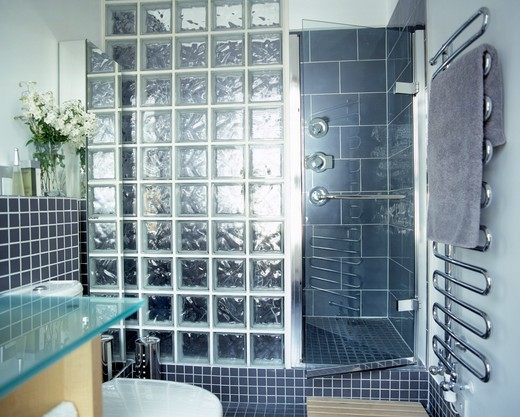 Stock Photo: 4291-2710 Fully tiled grey bathroom with glass brick shower screen