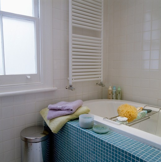 Stock Photo: 4291-2896 Small white bathroom with turquoise tiled bath side