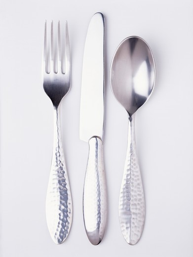 Close-up of silver knife and fork with spoon : Stock Photo