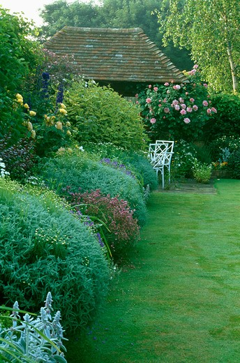 Lawn and herbaceous border in large country garden in summer : Stock Photo