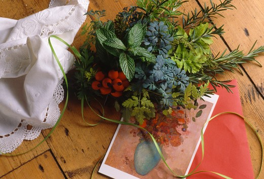 Stock Photo: 4291-5549 Still-Life of posy of fresh herbs on floral post-card