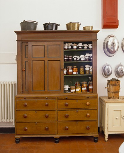 Stock Photo: 4291-6937 Preserves and jams stored in antique kitchen dresser