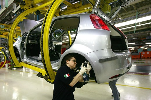 Stock Photo: 4292-100752 Italy, Piedmont, Turin, Mirafiori. Worker in Fiat car factory assembling plant