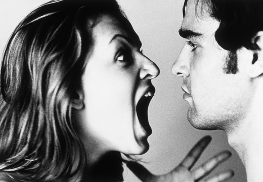 Stock Photo: 4292-101232 Couple arguiung, woman screaming to man