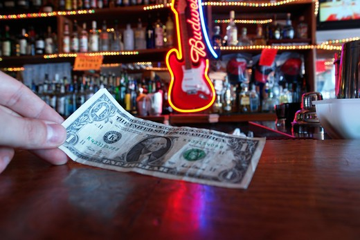 Stock Photo: 4292-103797 Man paying in a bar