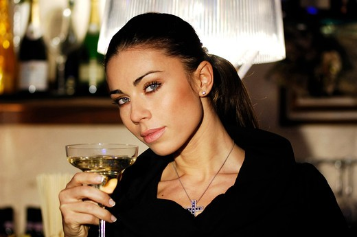Woman with a glass champagne : Stock Photo