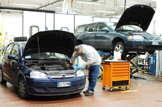 Stock Photo: 4292-104158 Mechanic in repair garage checking car's engine