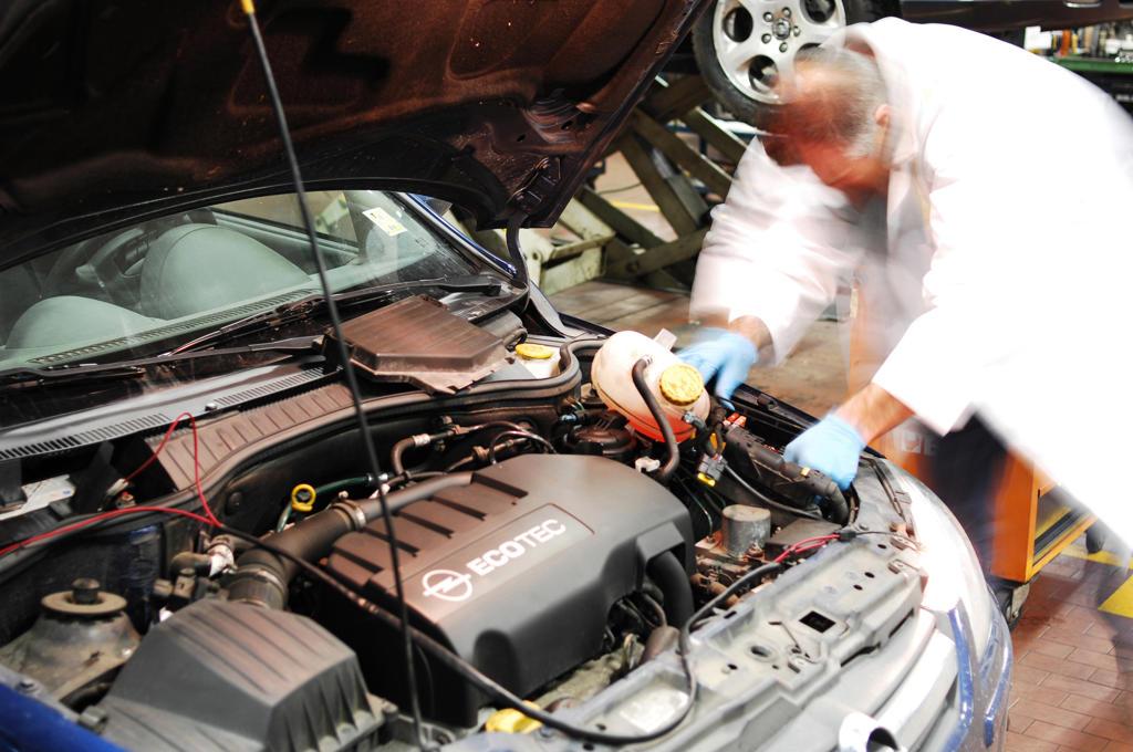 Stock Photo: 4292-104160 Mechanic in repair garage checking car's engine