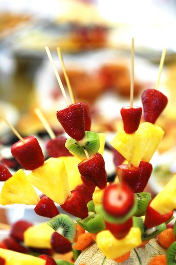 Colourful fruit skewers : Stock Photo