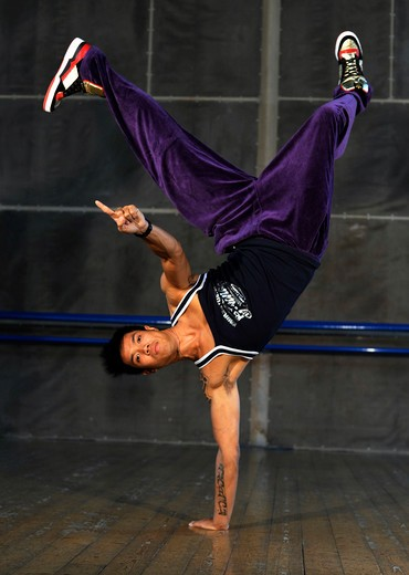 Stock Photo: 4292-104478 Male dancer training in dance studio