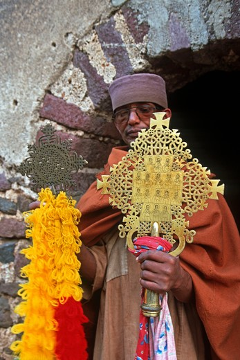 Stock Photo: 4292-106090 Ethiopia, near Bahar Dar, Kebran Gabriel Church, man holding a crucifix