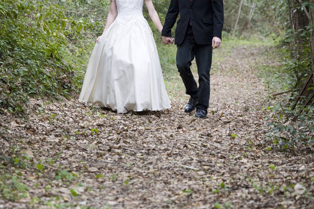 Stock Photo: 4292-107405 Bride and groom at garden