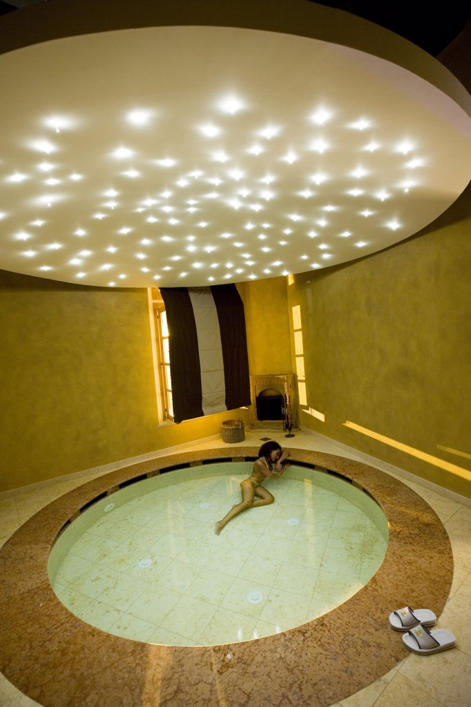 Italy, Tuscany, Casciana Terme Terme, Villa Borri, woman in thermal pool : Stock Photo
