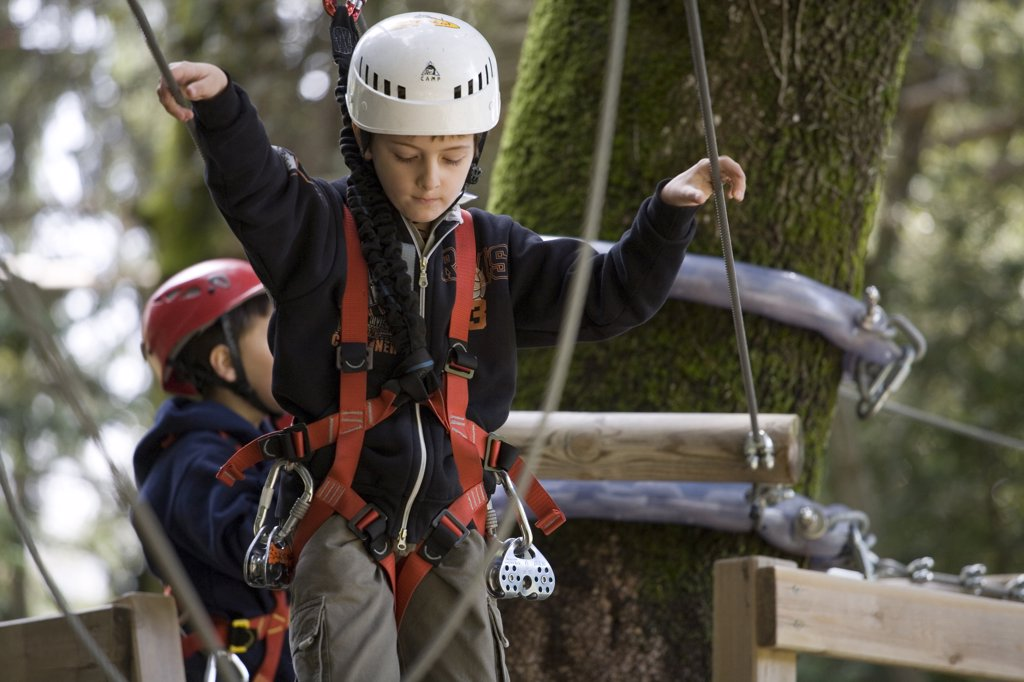 Stock Photo: 4292-107676 Italy, Liguria, Giandriale (La Spezia), boys at adventure park