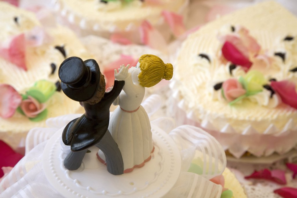 Groom Figurines on Wedding Cake : Stock Photo